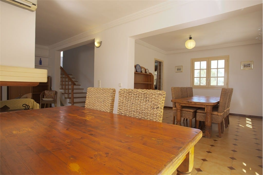 Spacious dining room at Villa Maria with two tables and chairs