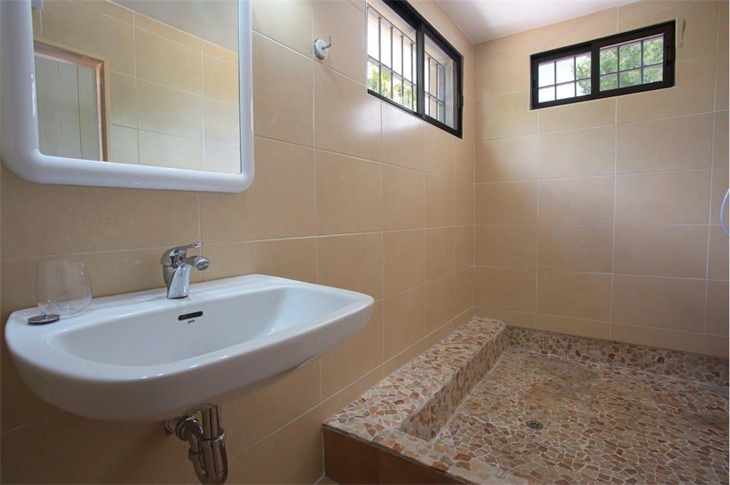 Large mosaic shower and sink at Villa Maria