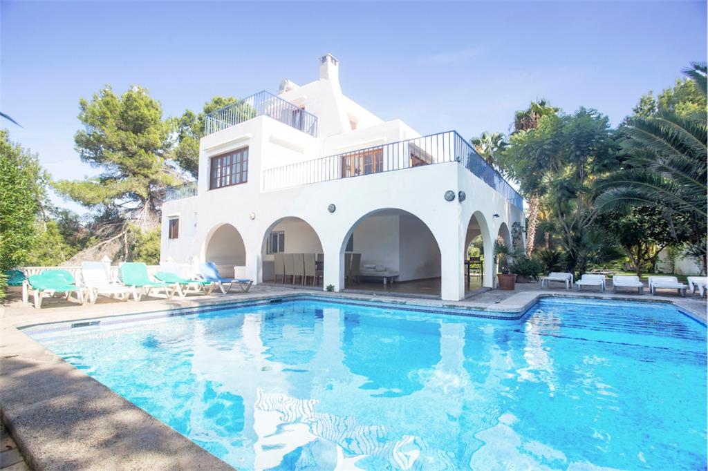 Large l shaped pool and terraces outside Villa Maria