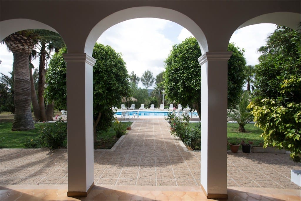 Arches lead to pool and gardens at Villa Nieves