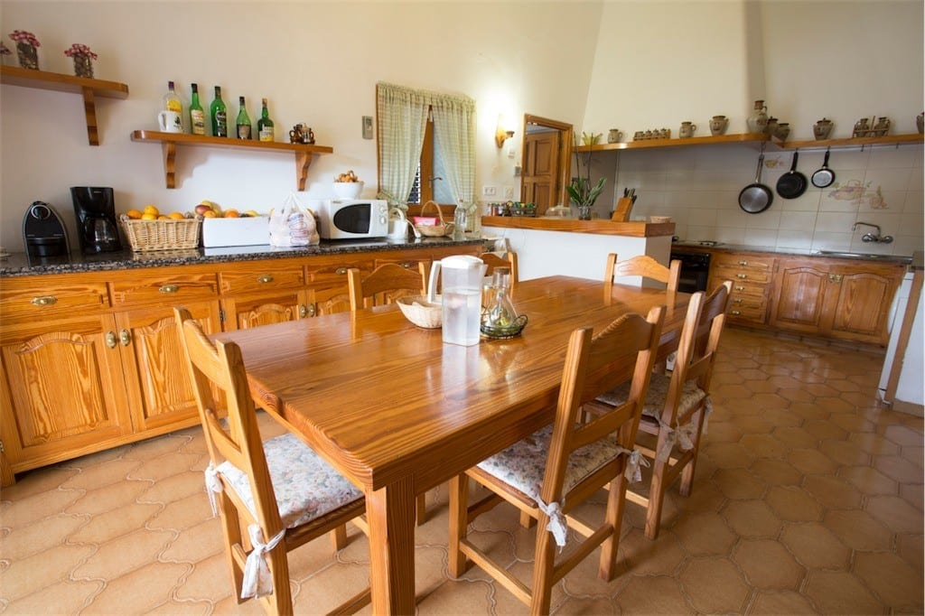 Traditional country kitchen with large wooden dining table