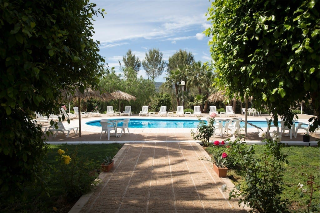 Large pool and terrace with sun loungers at Villa Nieves