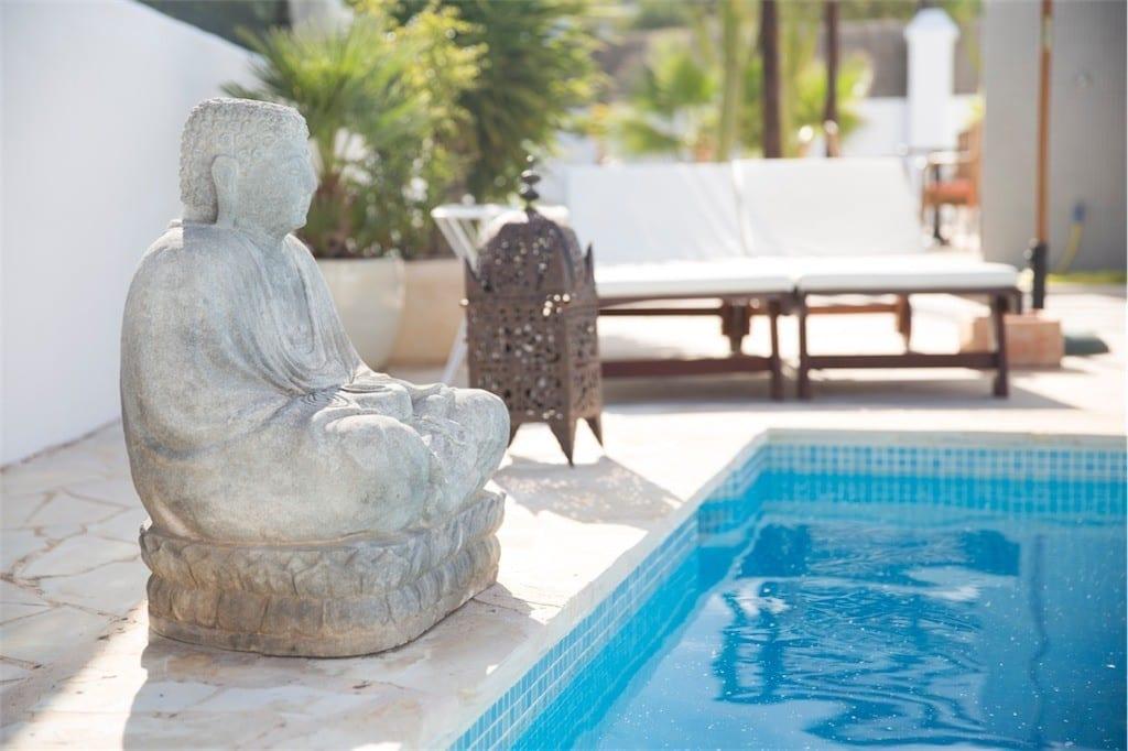 buddha statue by pool at casa carolle ibiza