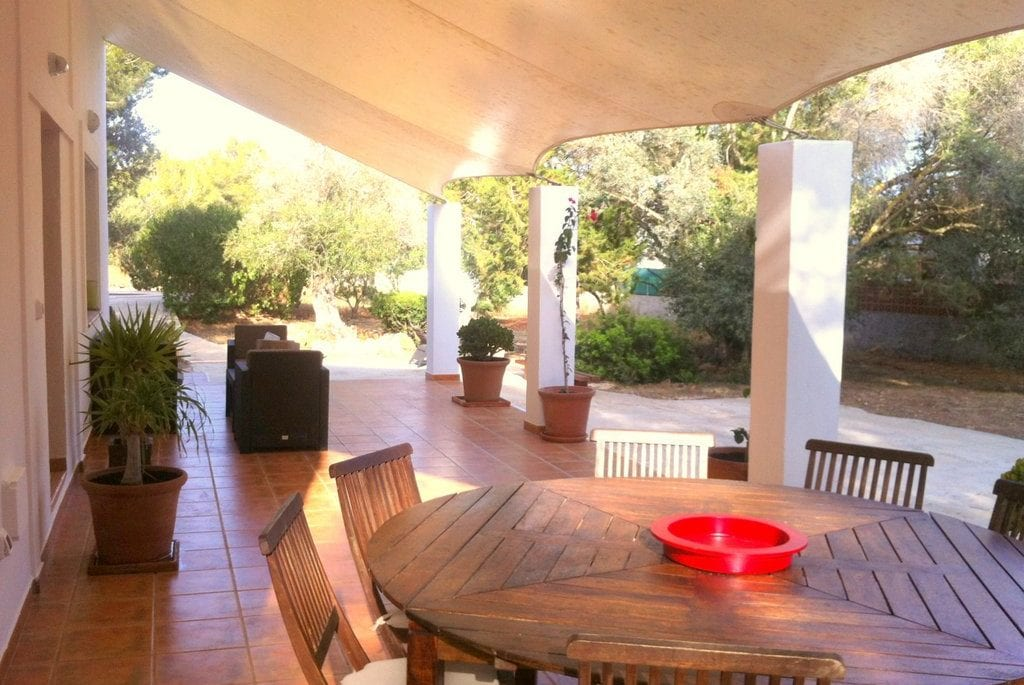 Wooden dining table and chairs on outside terrace