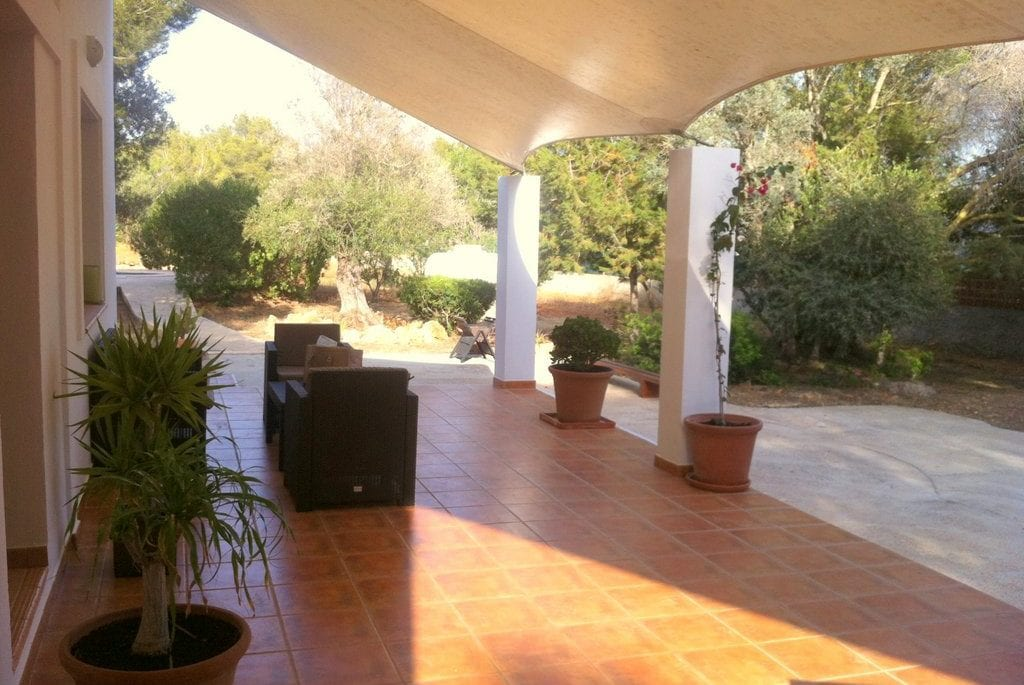 Lovely covered porch and seating at Villa Tinto