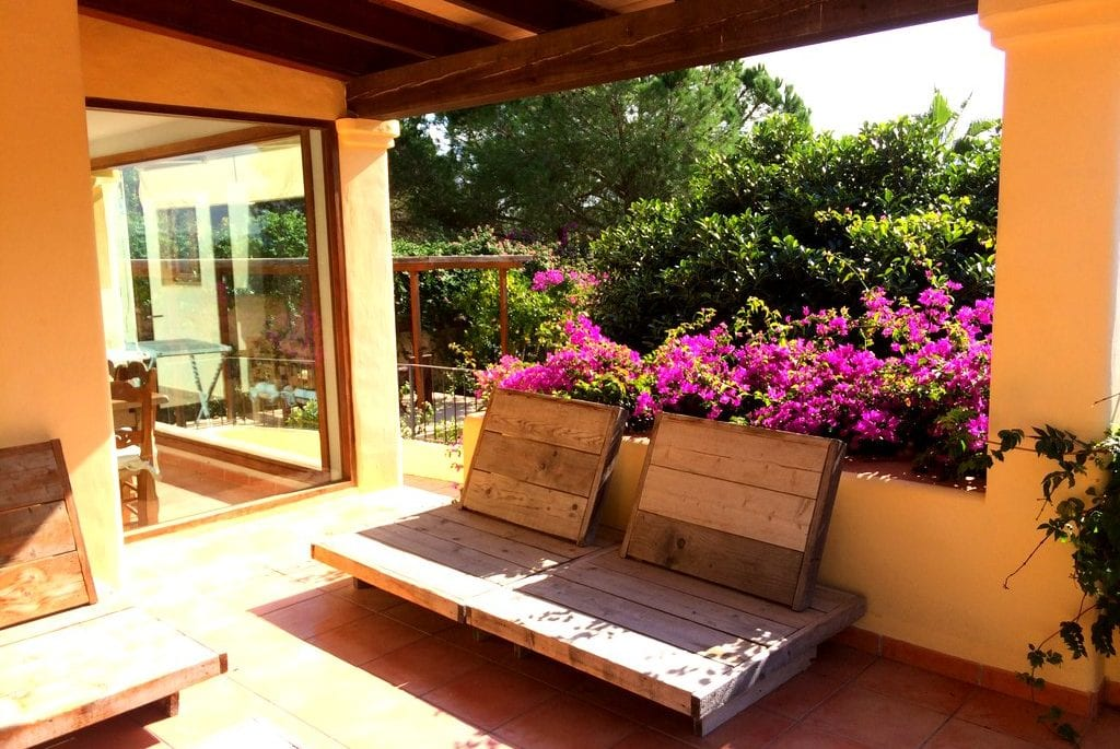 Rustic terrace furniture at Villa Los Olivos