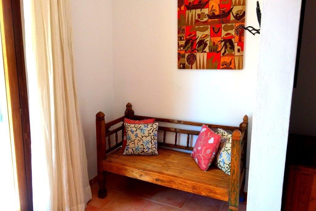 Small wooden alcove seat