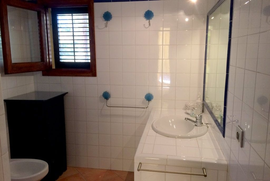 White tiled bathroom and sink