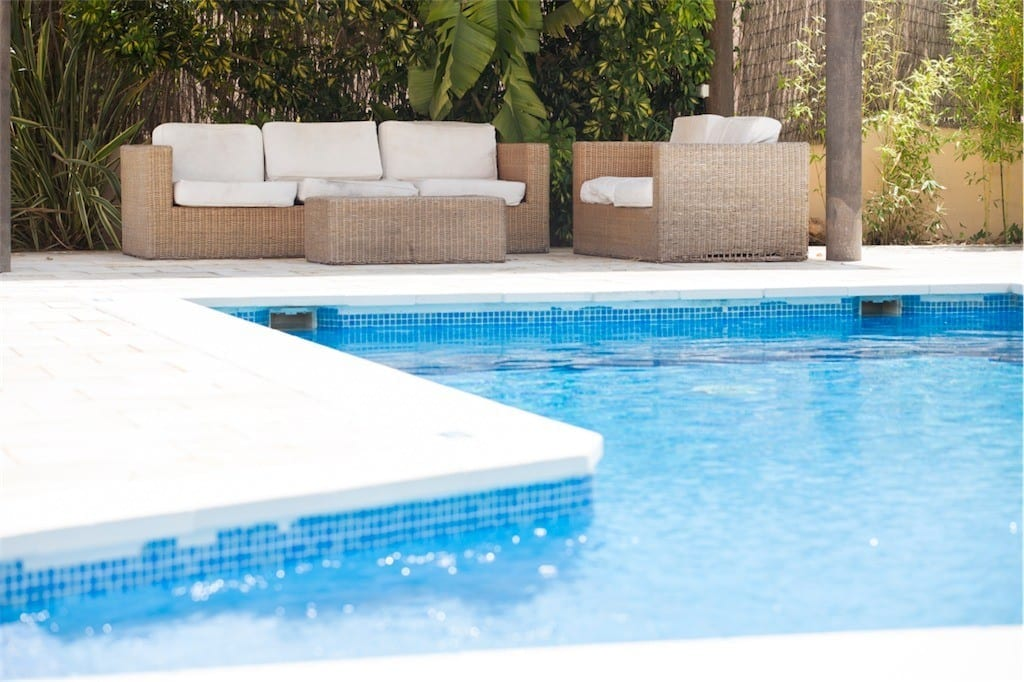 Comfortable seating next to the pool at Villa Tom