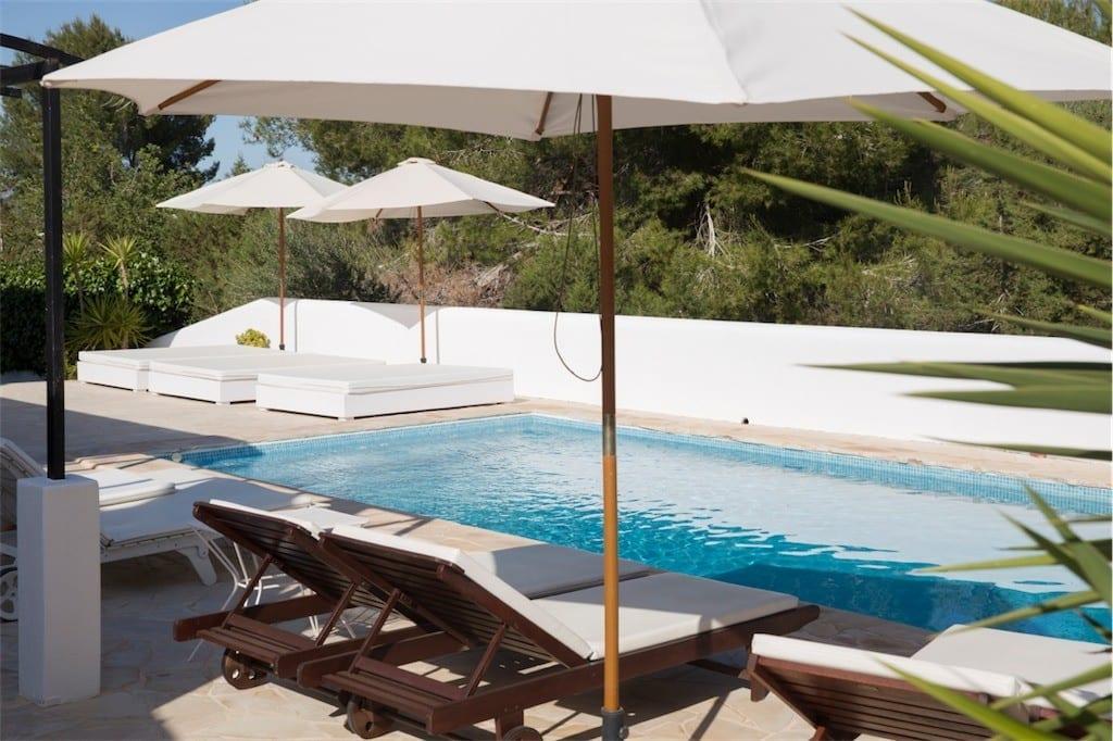 sun loungers and umbrellas at casa carolle ibiza