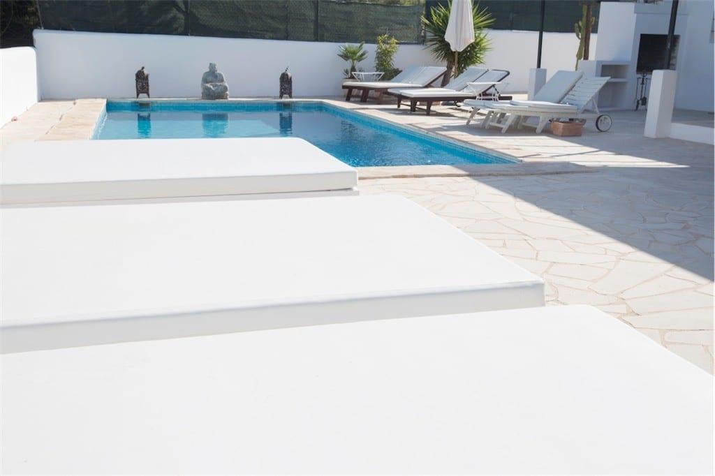 sunbeds and pool at casa carolle ibiza