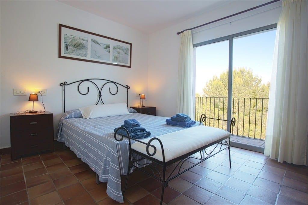 double bedroom with balcony at casa carolle ibiza