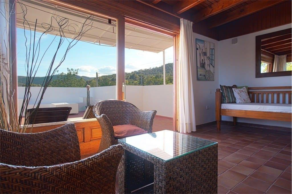 upstairs living room and terrace at casa carolle ibiza