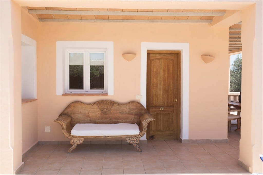 Lovely wooden sofa on front terrace of Villa Tom