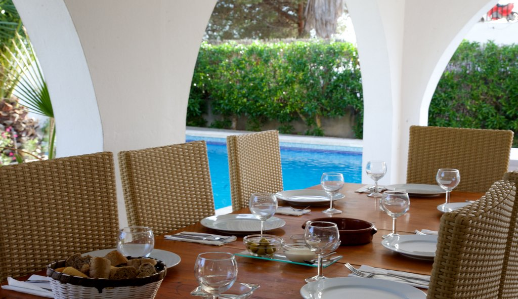 dining table by swimming pool