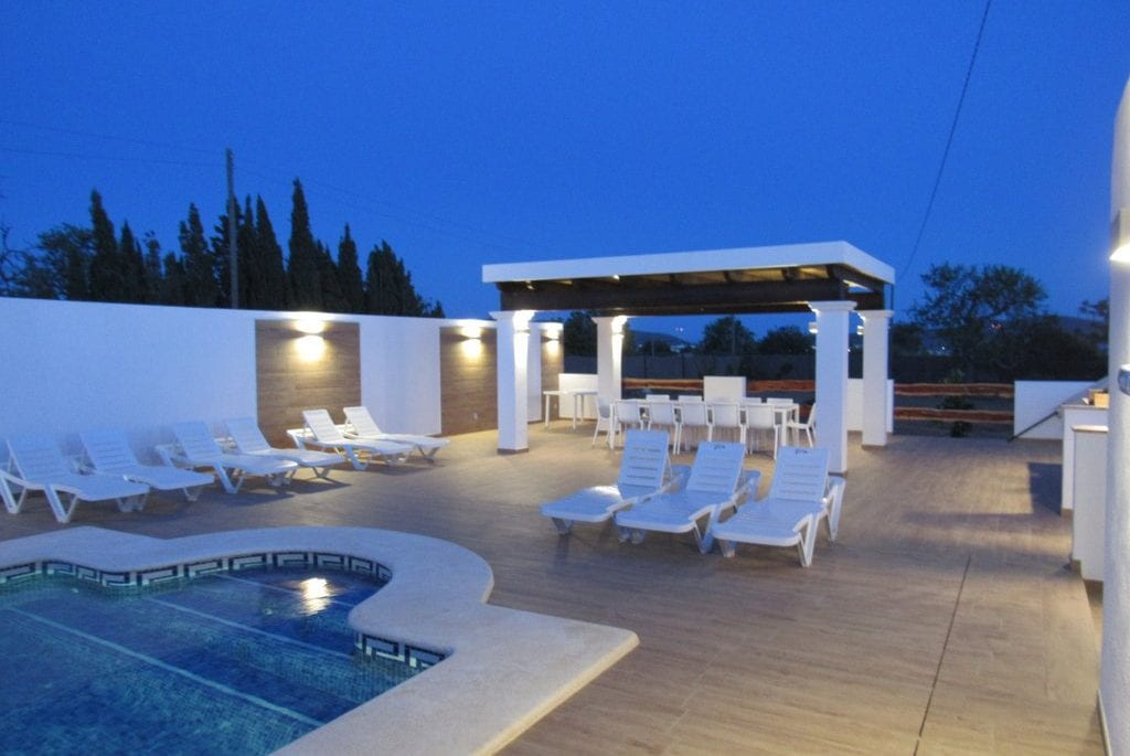 Night shot of pool and terrace