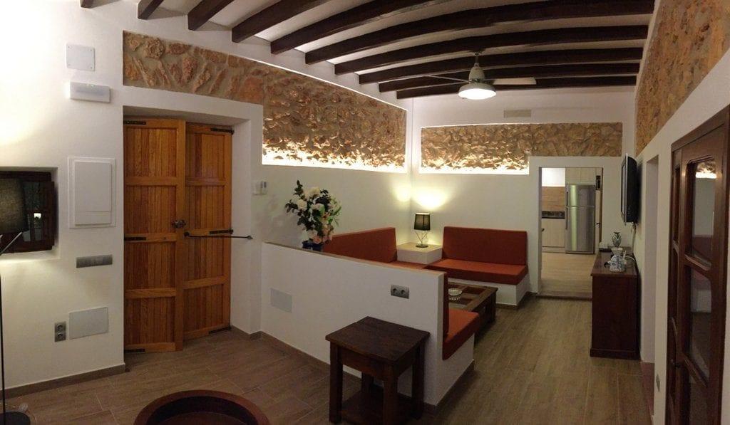 Refurbished lounge with natural stone walls and beams