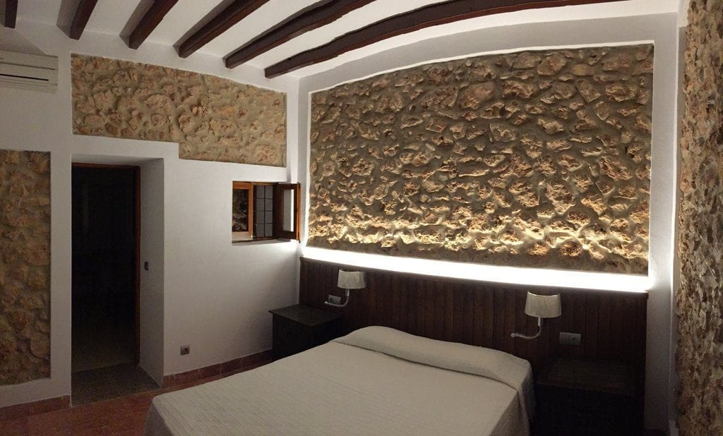 Double bedroom with feature stone walls