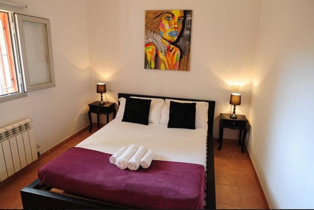Double bedroom with feature art