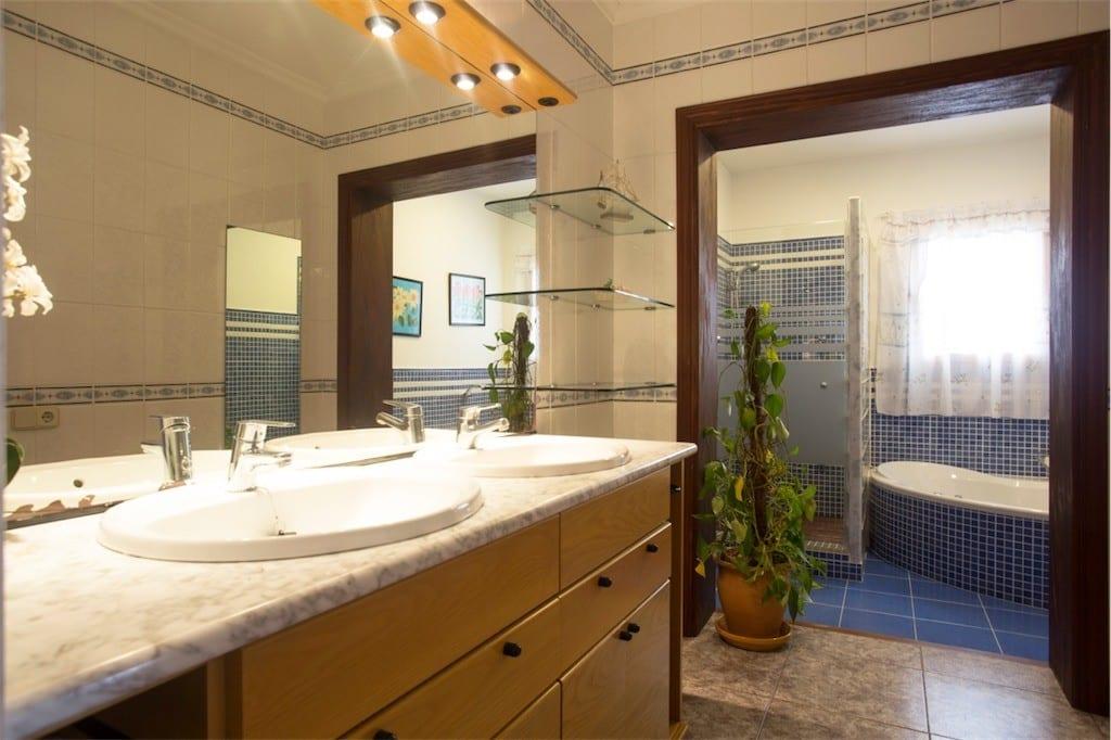Large modern bathroom with corner bath