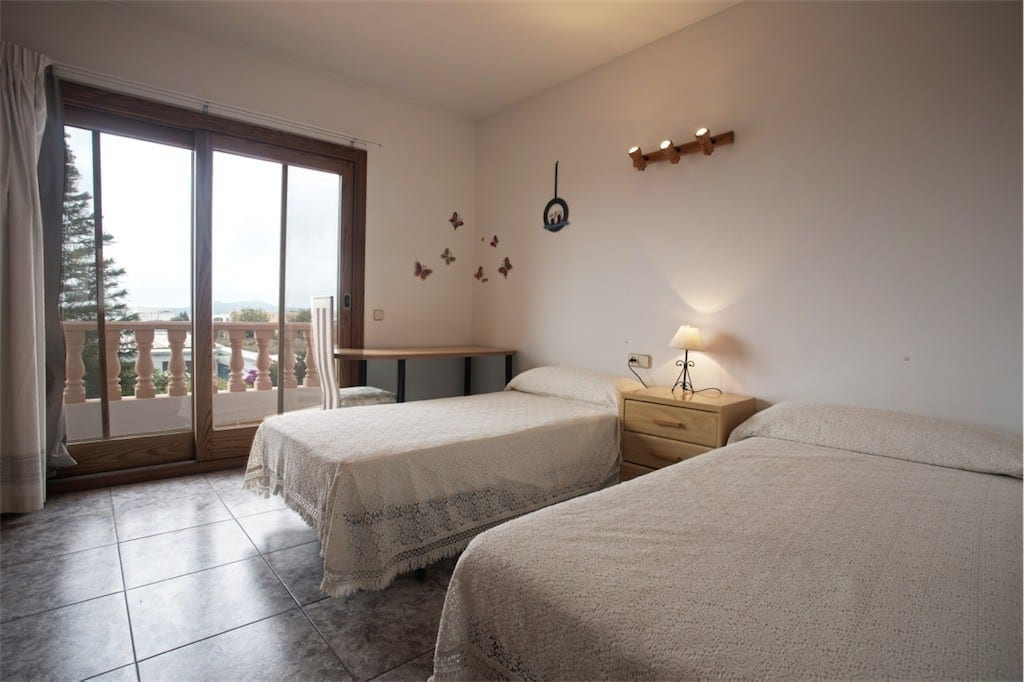 Spacious twin bedroom with access to terrace