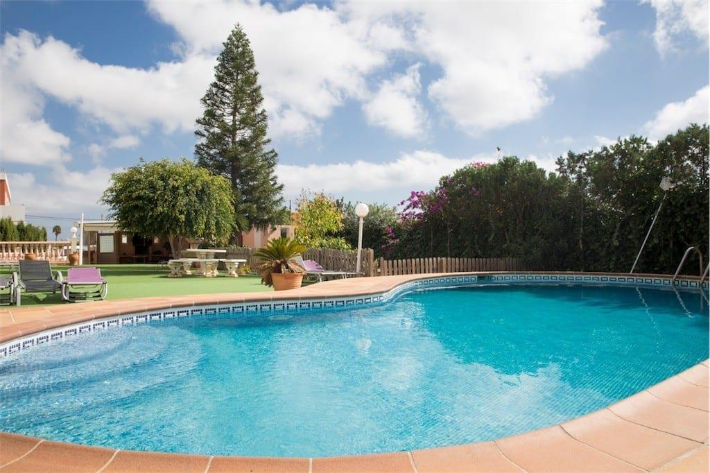 Large pool with roman steps and gardens at Villa Saroca