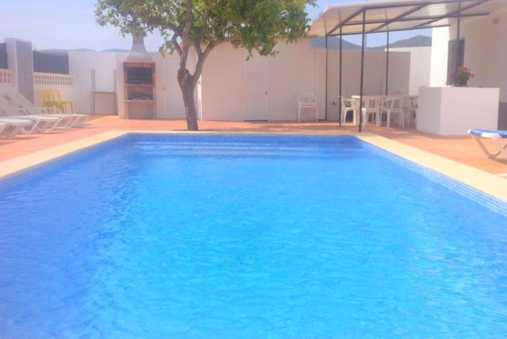 Large pool at Villa Torres with BBQ and dining area