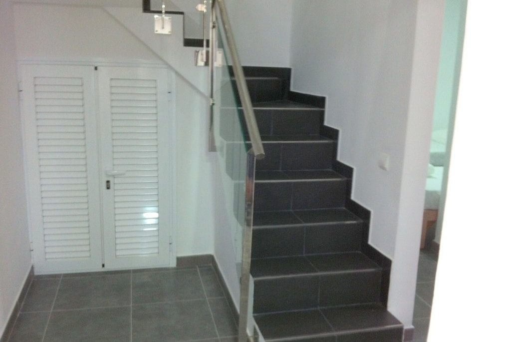 Black tiles and glass make this attractive staircase