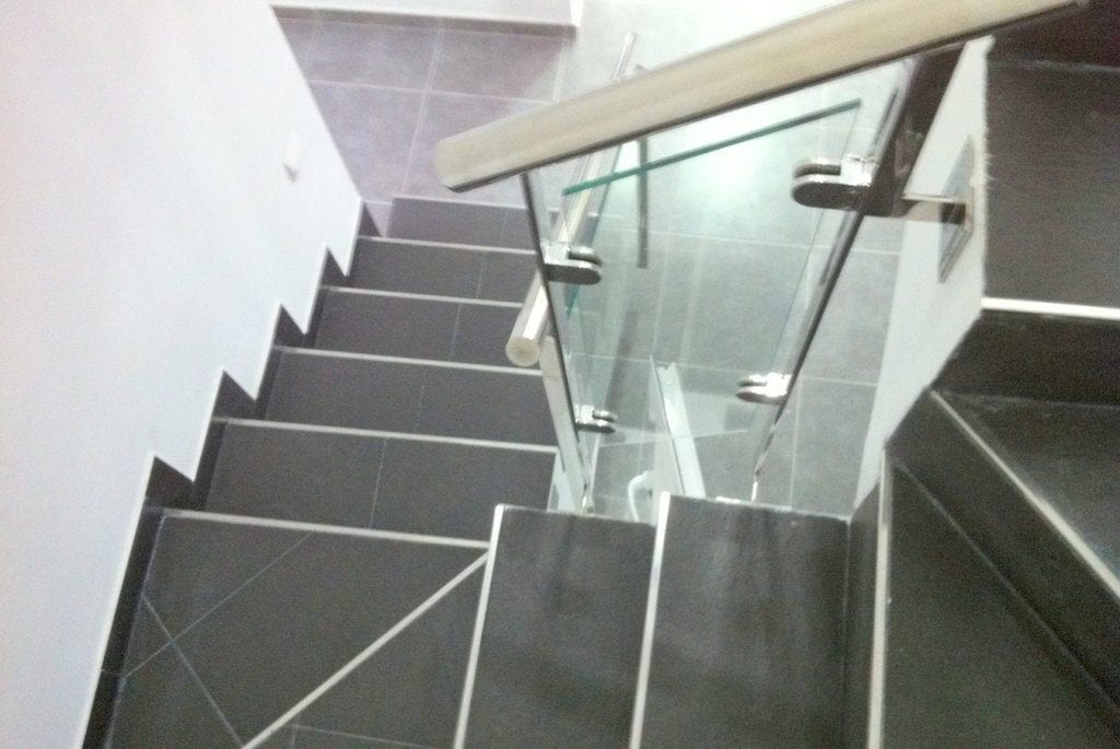 Glass and tiled staircase at Villa Torres