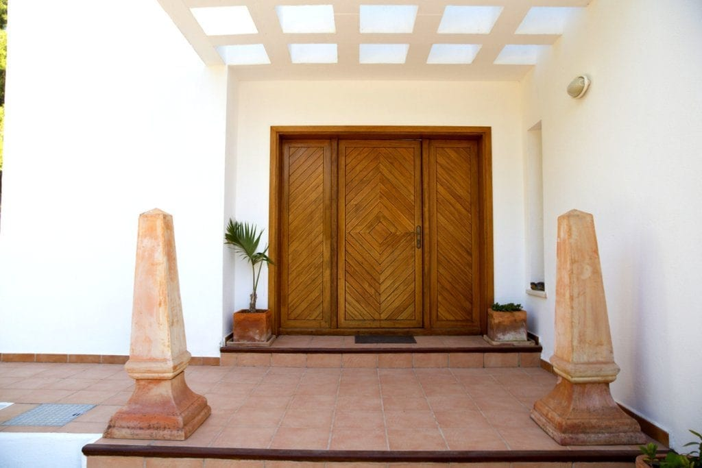Large wooden doors at the entrance to Villa Louisa