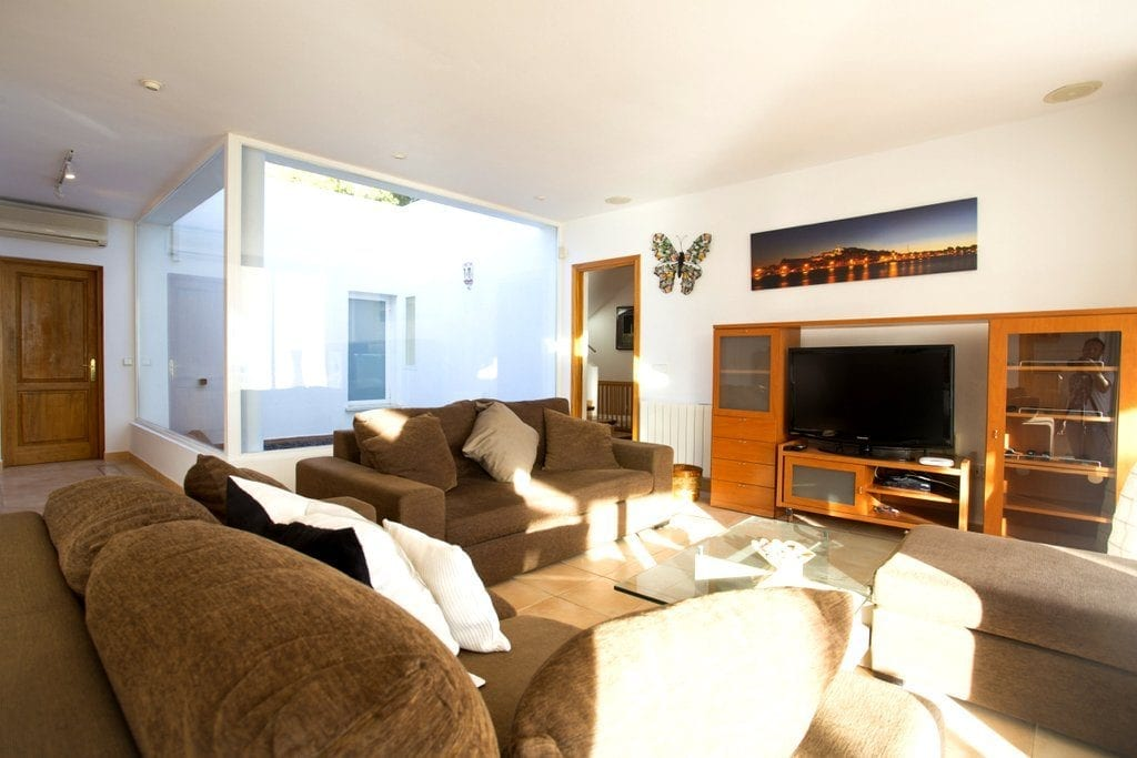 Internal Lounge with comfortable furniture and large TV
