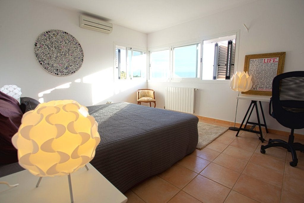 Spacious Master Bedroom with air conditioning and funky lamps