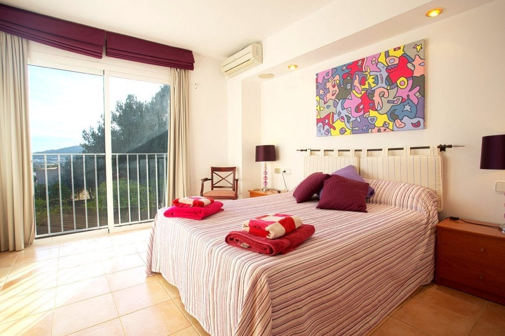 Spacious Double Bedroom with funky picture and doors to terrace