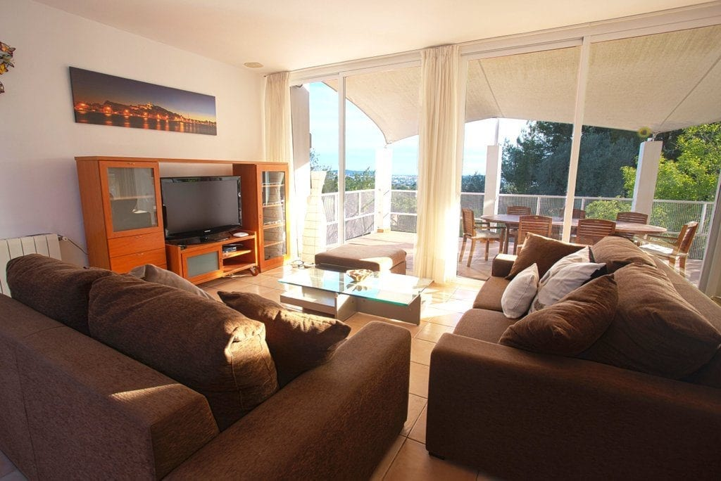 Comfortable sofas and large TV in lounge at Villa Louisa