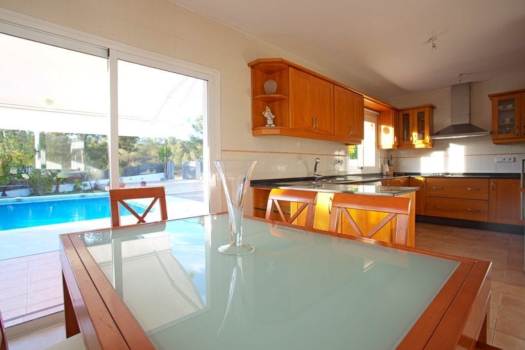 Dining Room area off the large kitchen overlooking the pool and garden